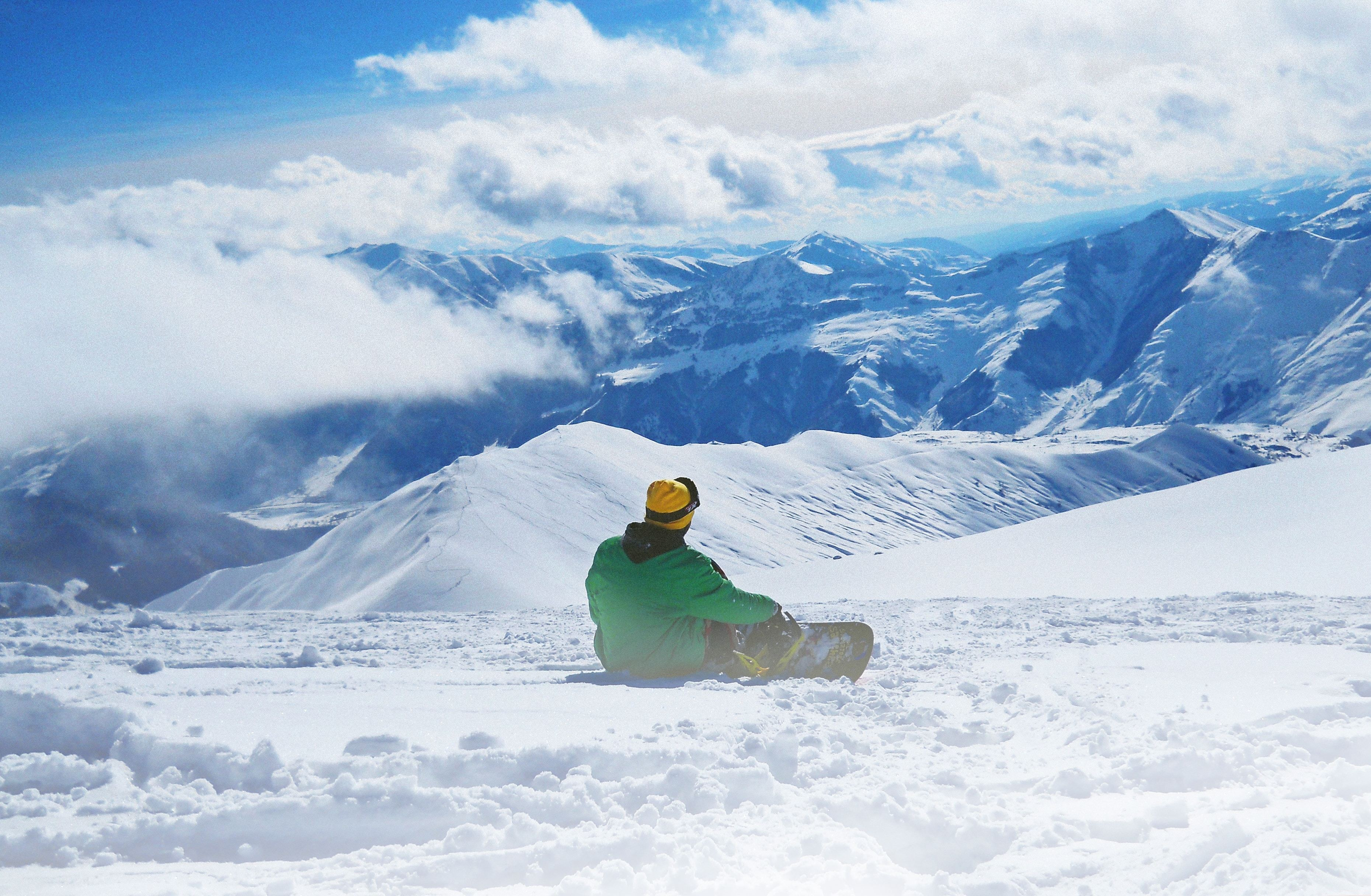 Snowboarder and mountains